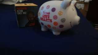 a photo of a pottery pig money box