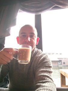 photo of author, and writer Steve Alexander drinking coffee and enjoying time out