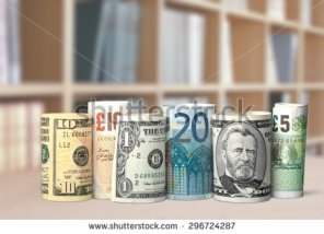 an image of different types of currency rolled up
